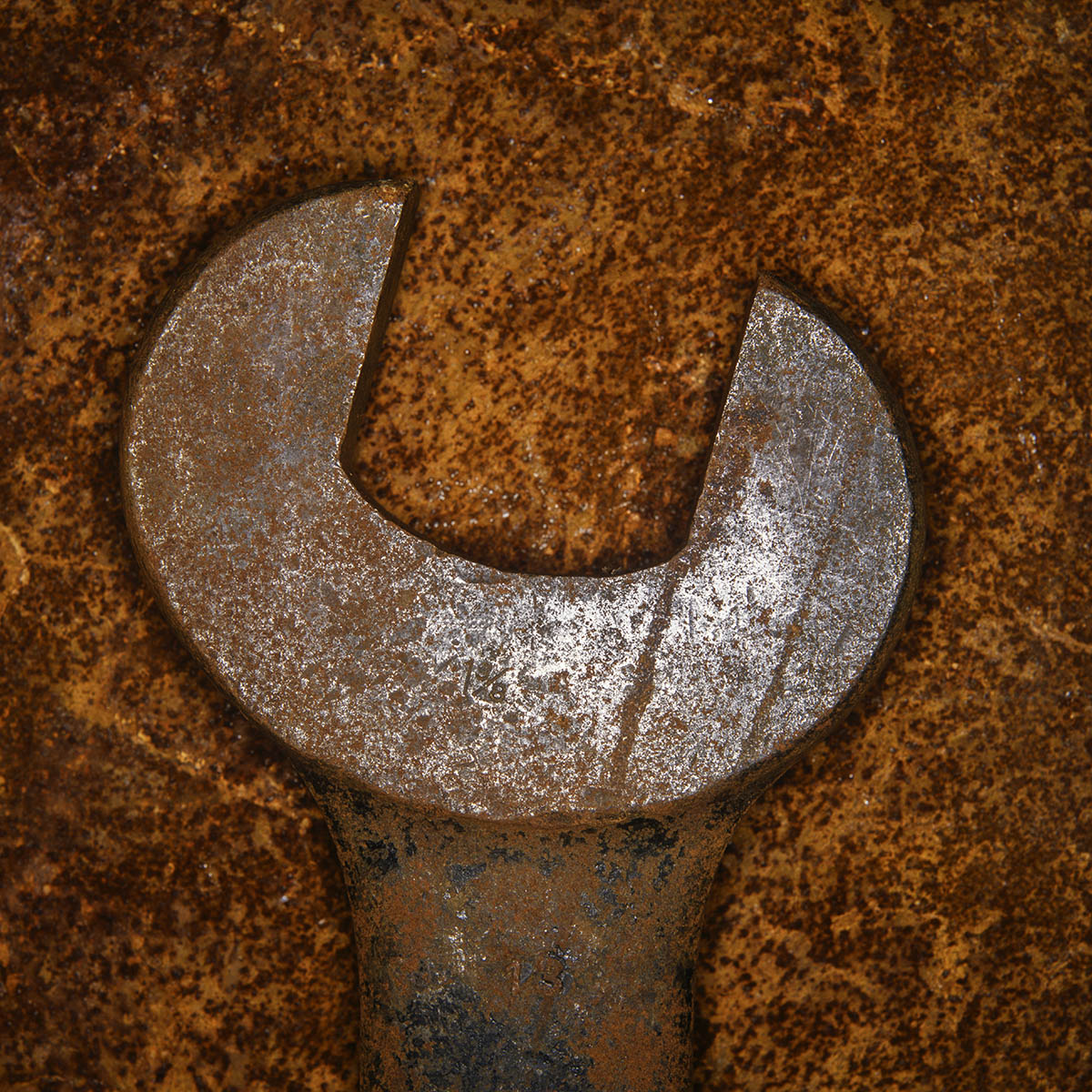 Free stock photo Rusted old wrench on a rusted background