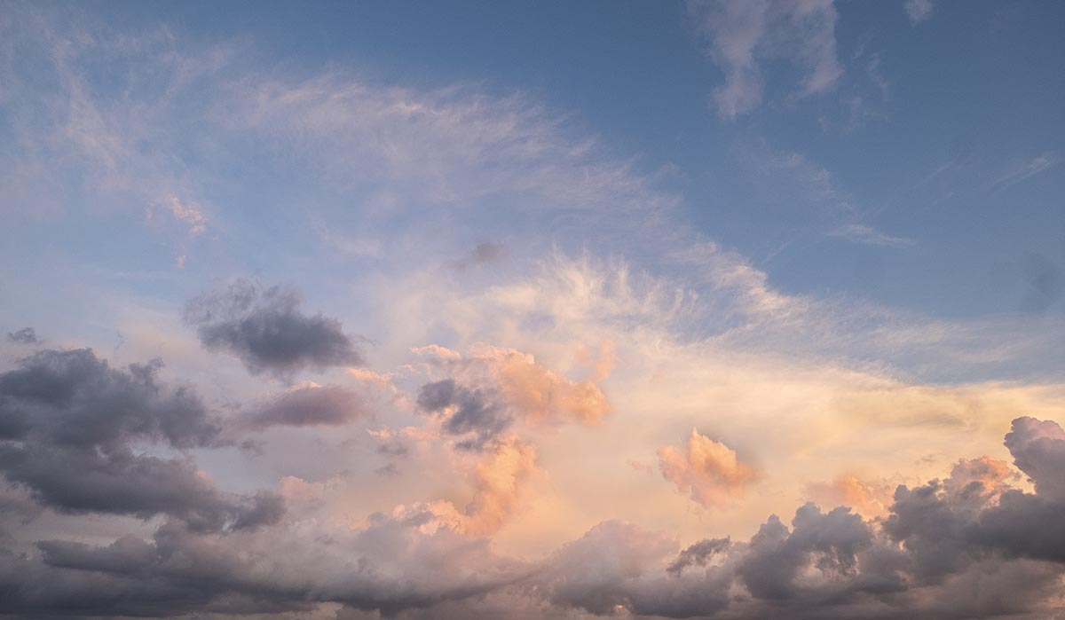 Free stock photo Colorful sunset cloud formation in a blue sky