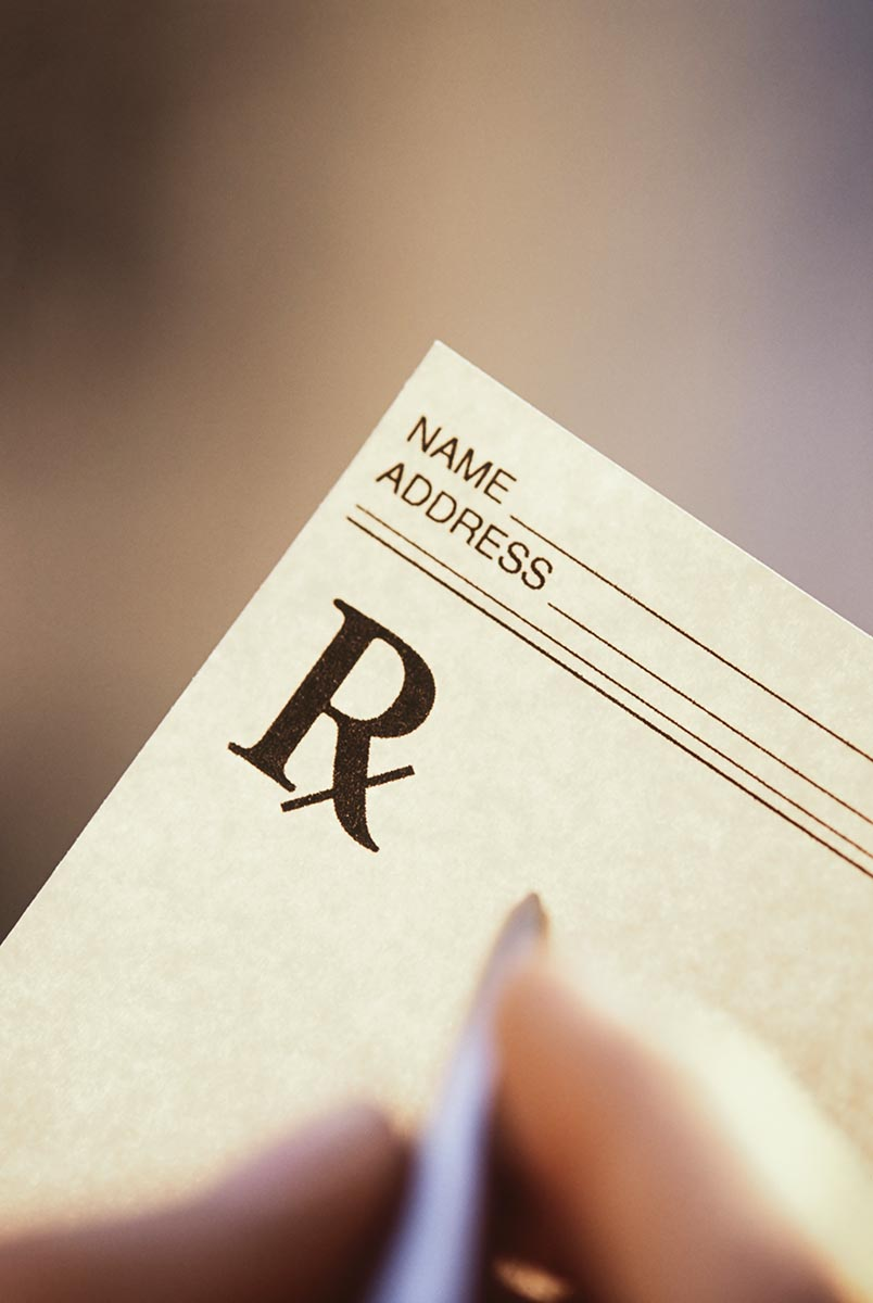 Free stock photo Physicians hand filling out a prescription