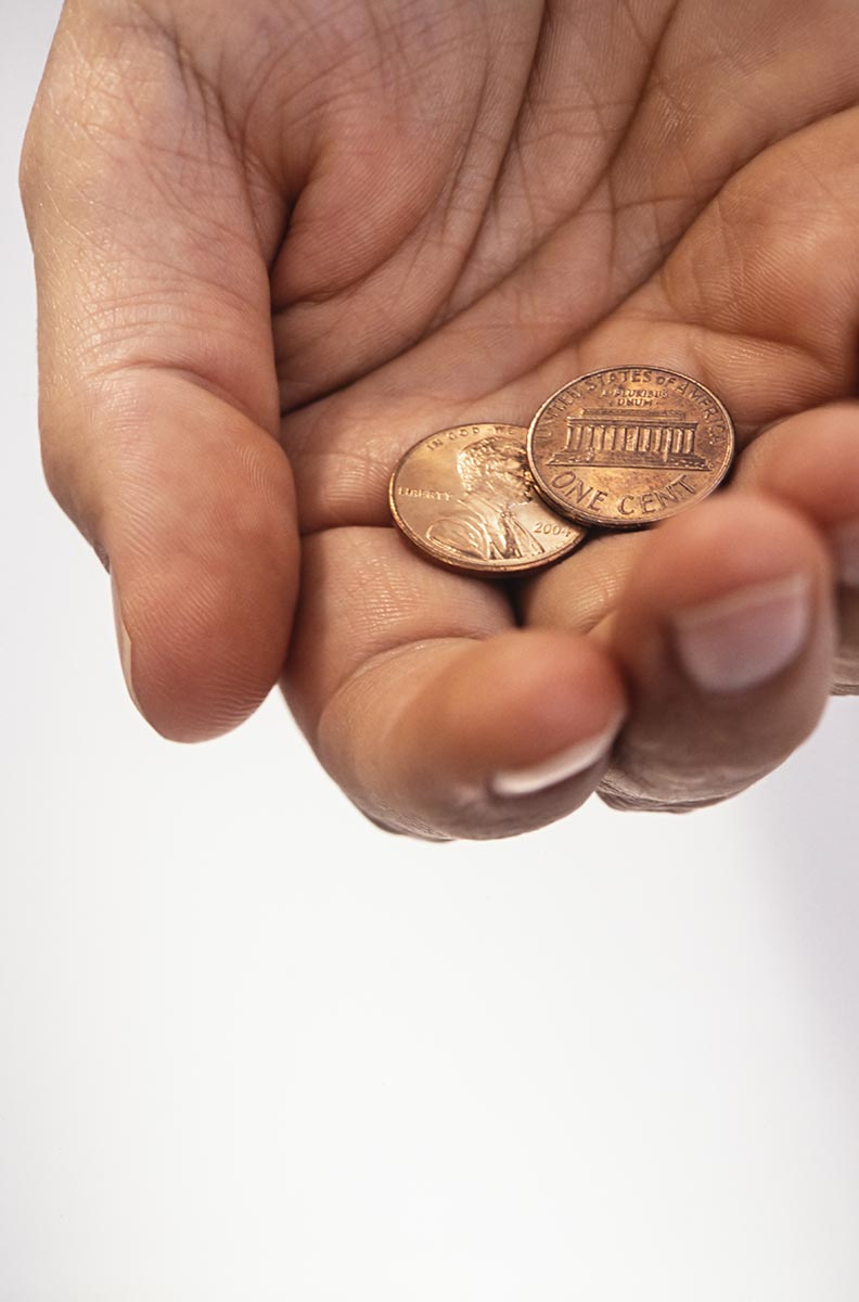 Free stock photo Man's hand holding two cents