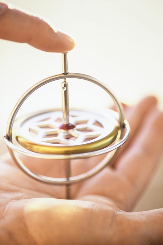Free stock photo Man's hands balancing a gyroscope