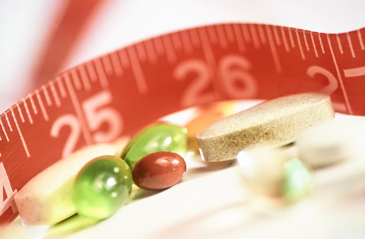 Free stock photo Health supplements and tape measure