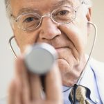 Free stock photo Doctor about to use a stethoscope on a patient