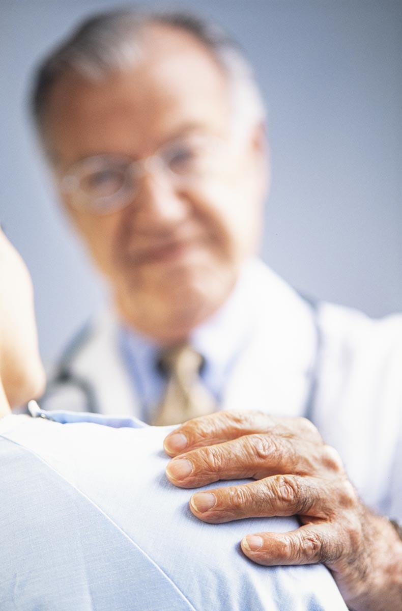 Free stock photo Doctor's hand on a patient's shoulder while giving advice