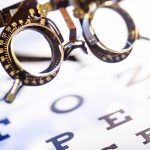 Free stock photo Old opticians phoropter resting on an eye chart