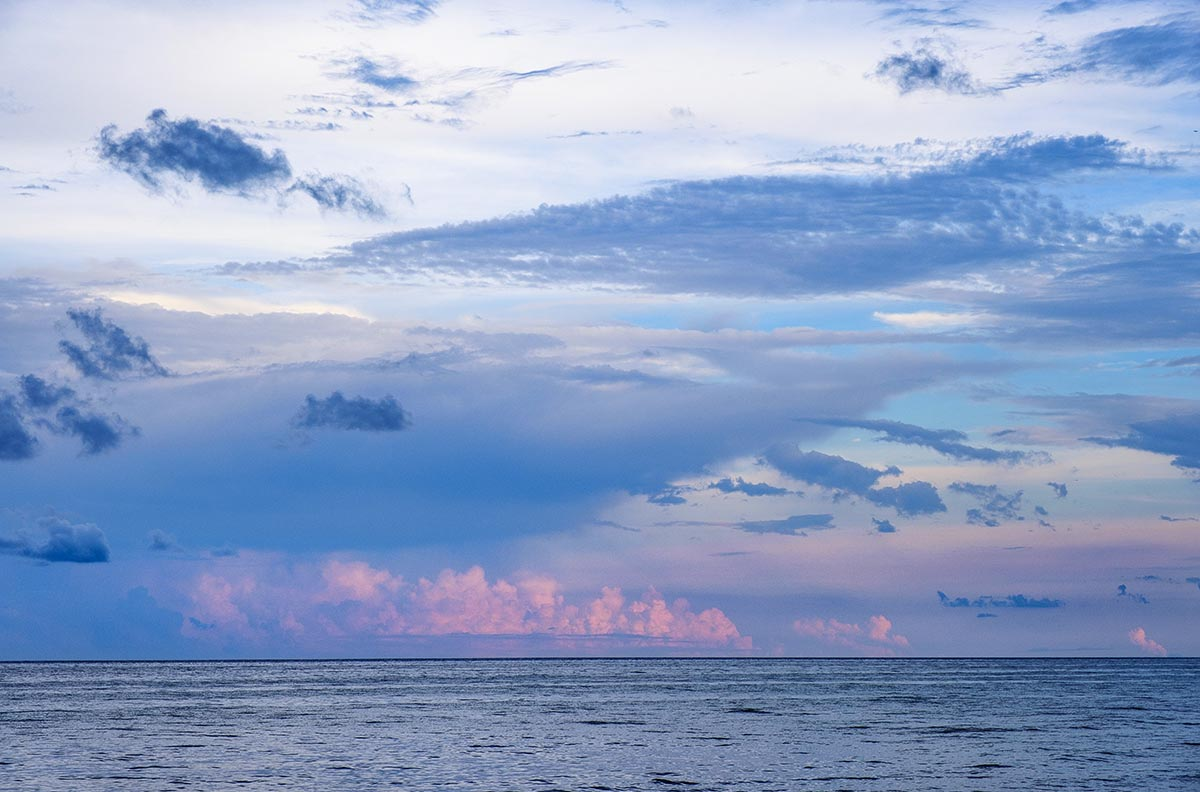 Free stock photo Pink clouds over an ocean sunset