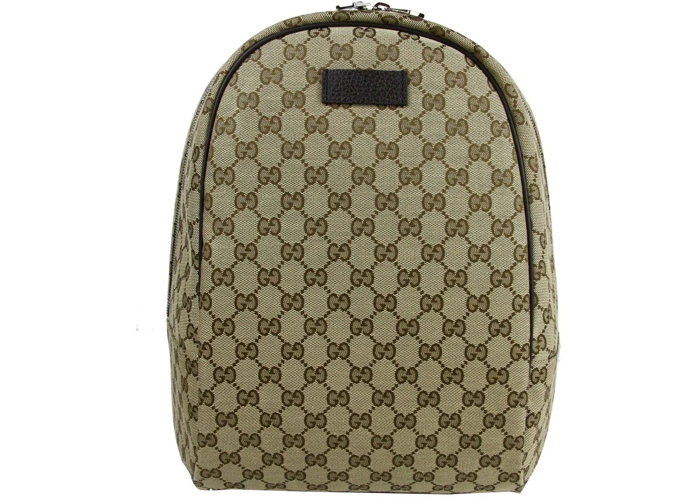 83486426bf7a This Gucci Top Zip GG backpack in Gucci Monogram has a top zip closure