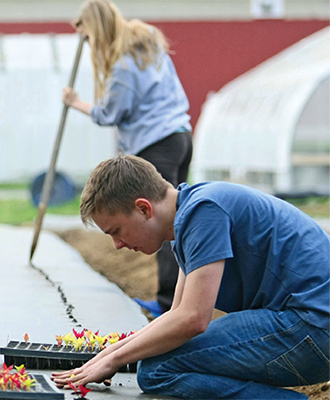 Faculty Focus 2014 Students on the farm
