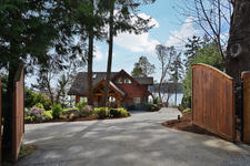 West Coast Log Home on Platinum Mile Beach in Sechelt For Sale