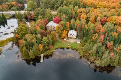 Magnetawan River Waterfront Home for sale with access to 3 lakes! Under $750K