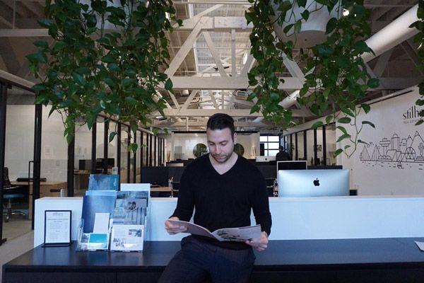 Dimitri Psihas reading newspaper