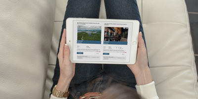 man searching real estate on ipad