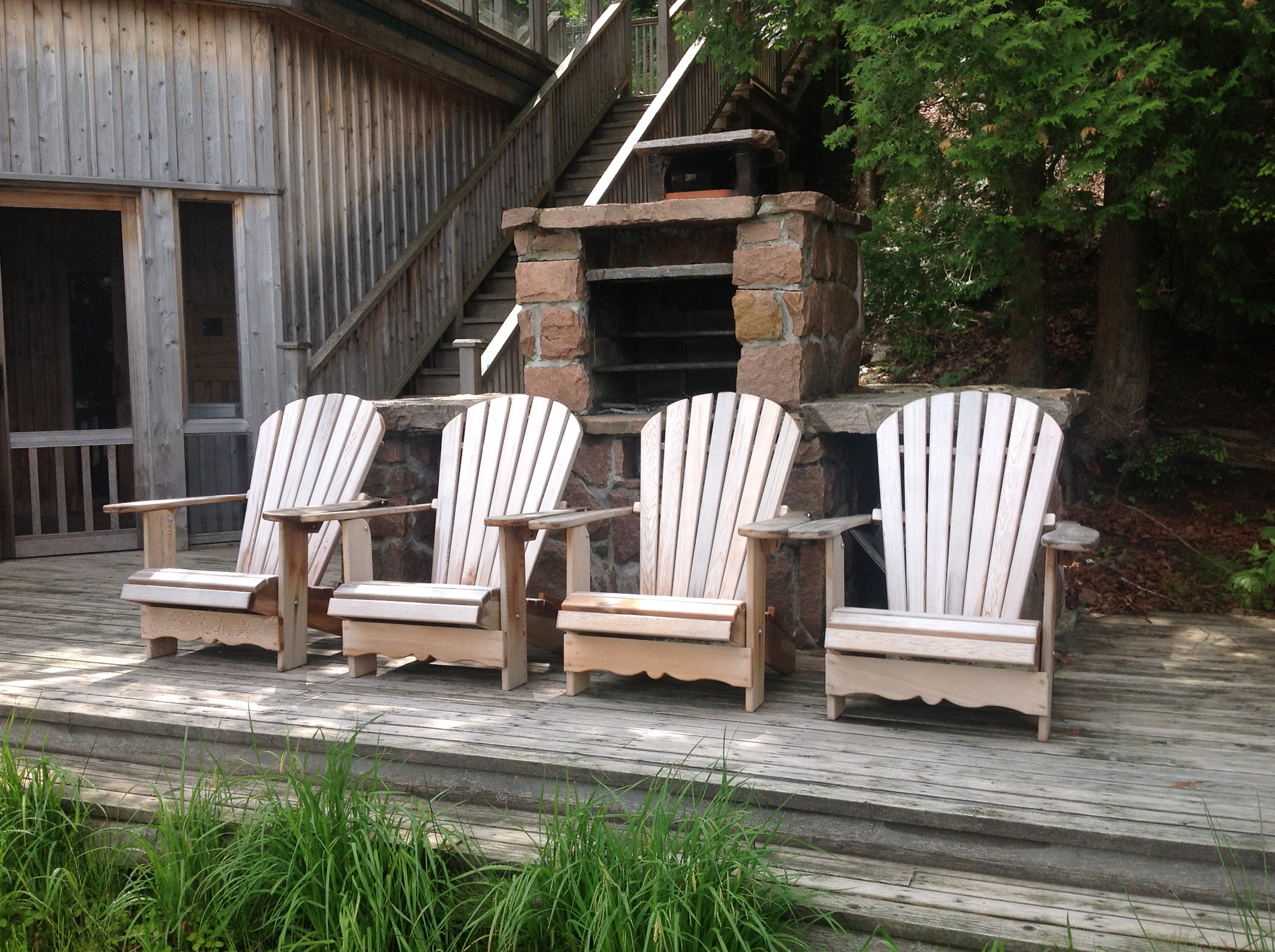 Muskoka chairs on a dock