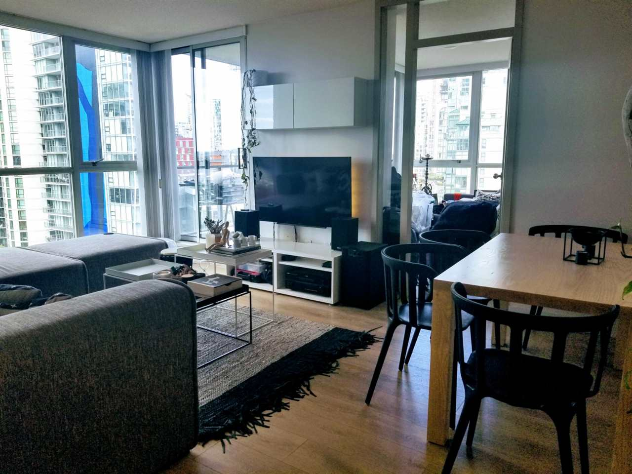 Family room and kitchen in West One, Yaletown condo