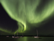 Sailing beneath the Aurora Borealis