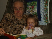 GRANNY AND SARAH READING GOODNIGHT MOON.