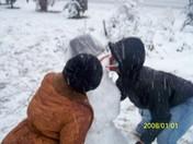 mary n maria kissin the SNOWMAN :)