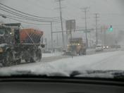 Snow Plows On Their Job