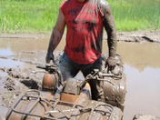 Shawn playin in the mud on the 4wheeler