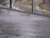 Rain cascading down Alta Sierra Dr