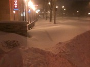 Snow covered sidewalks down Wisconsin Ave