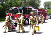 Firefighters with gear (Photo by Dustin Alexander)