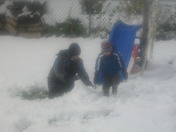 noah & ethan  playing in the snow