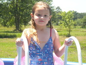 Granddaughter Mckenzie in the pool