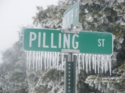 Icicles on a street sign
