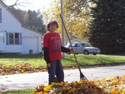 Our 13 Year Old Son Raking Leaves