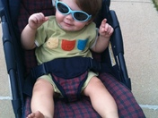 Grandson Rylan loving the weather and his new shades.