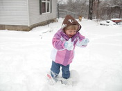 Grandaughter playing in snow