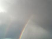 a rainbow after a shower