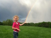 Tabbi catching a rainbow in Duncan, Ne