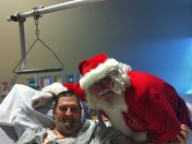 Santa Pays Gar-a-bus-b a visit at Mercy