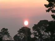 Ash cloud orange sunrise from Monterey