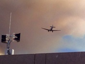 DC-3 did multiple approaches to Monterey Airport under the cap of ruddy smoke