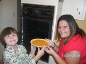 Putting the pumpkin pie in the oven