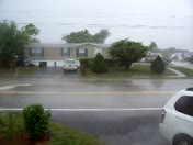 Wind-blown rain down the street