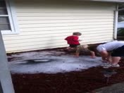 Kids playing in the hail from last night's storm at Holiday Pines in Fort Pi