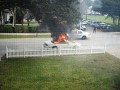 heard a boom, see this camaro on fire in my front yard.  luckily the firetruck g