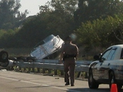 Another view of the flipped over truck and boat on the Florida Turnpike today.