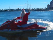 Santa leaving downtown WPB waterfront on jet ski!