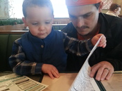 my son enjoying a meal with me between chemo