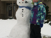 Natalie Neiman builds a snowman on her day off from St. Patrick Catholic School-