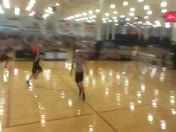 Freshman girl buzzer beater half court shot.