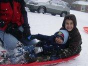 Ethan and Gavin Milligan sliding down hill backwards!