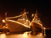 Navy ships lit up for the 4th