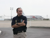 DHS agent in front of Russian Federation jet.