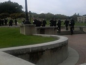 Busloads of police officers entering Soldiers and Sailors Memorial Oakland